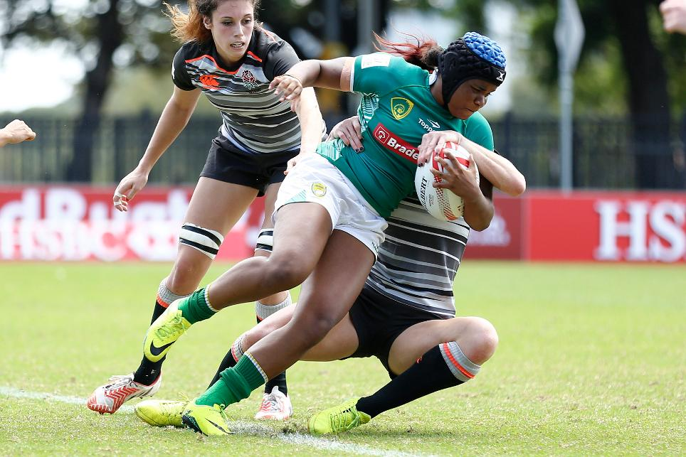 Beatriz Futuro Muhlbauer of Brazil is tackled by at Sydney 7s