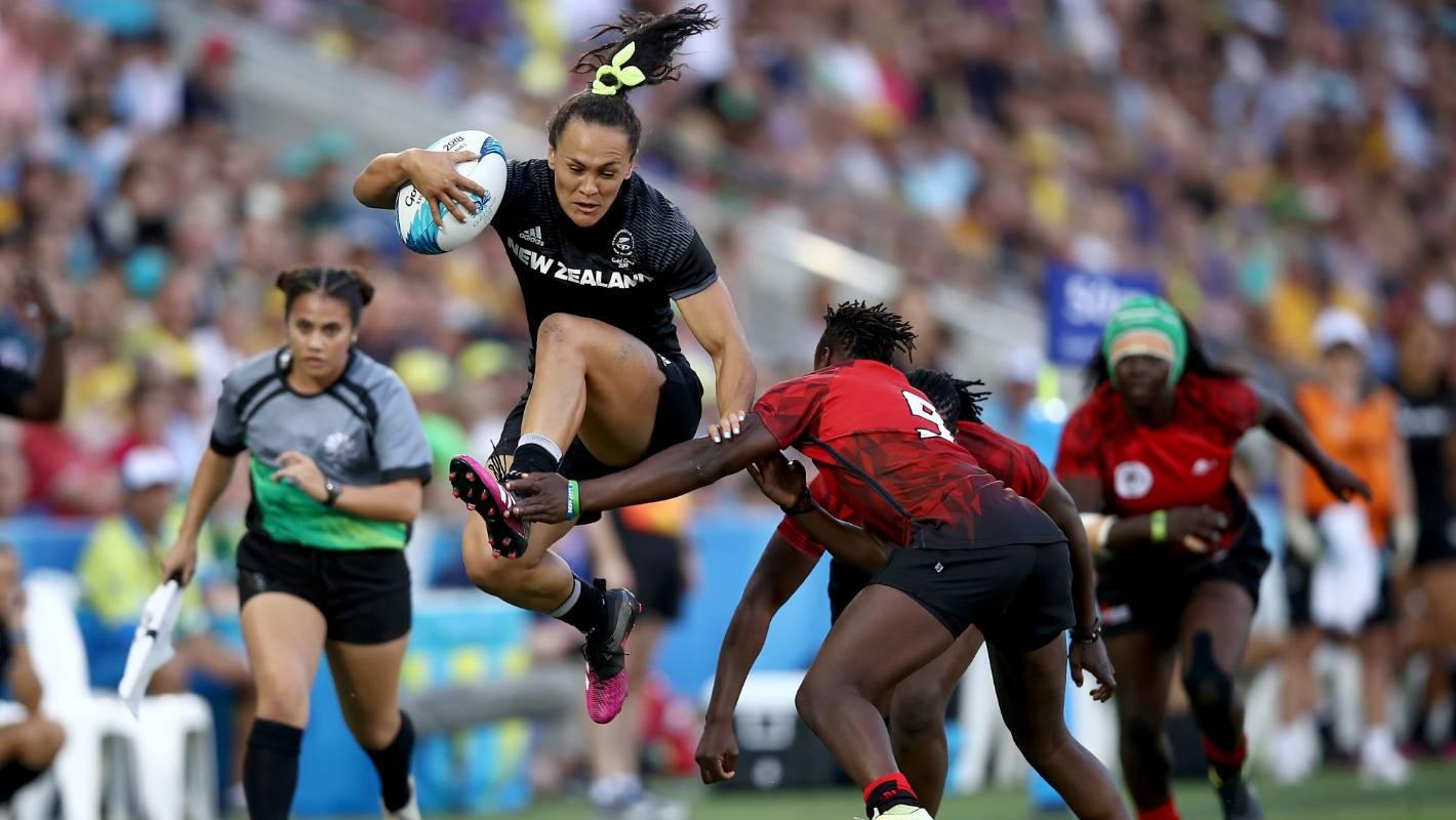 Portia Woodman jumps over defender